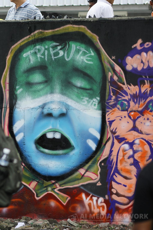 Potret penuh grafiti yang dihasilkan di salah satu dinding kat festival ni